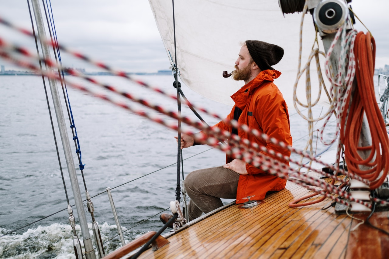 Why do pro sailing athletes need to wear gloves?